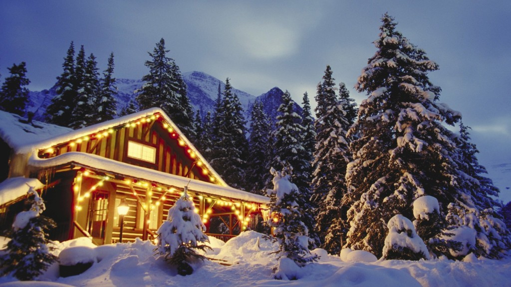 Christmas scene in beautiful snowing mountains