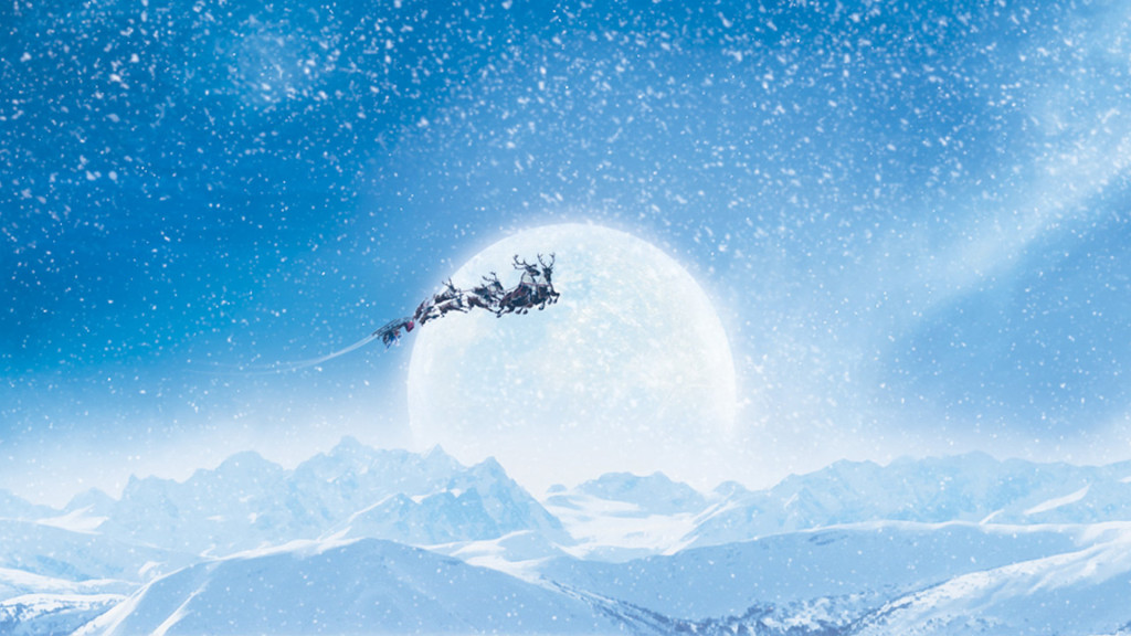 Santa above the clouds in his sleigh